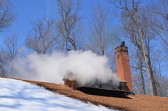 Steam billowing from a maple syrup sugar shack Royalty Free Stock Image