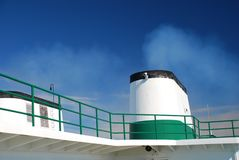 Boat chimney steam on blue sky Royalty Free Stock Photo