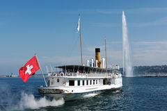 Steam boat leaving Geneva harbor Royalty Free Stock Images