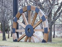 Steam boat wagon wheel. Vintage and historic round wood steamboat wheel in bismarck North dakota next to the missouri river in the park in the cool fall air Stock Photography