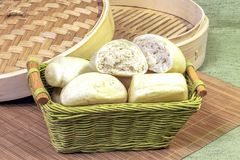 Steam buns in a basket. Steam buns in a bamboo basket royalty free stock photos