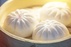 The steam buns in the bamboo basket. The Chinese traditional food royalty free stock image