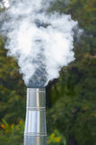 Steam from chimney Stock Photo