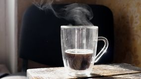 Steam comes from the cup. Hot steam rise under cup with fresh coffee or tea stock video