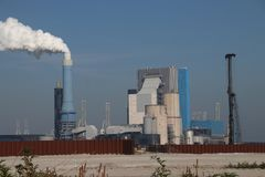 Steam comes out the chimney of the coal power plant of Engie in the Rotterdam Maasvlakte harbor in The Netherlands.  stock images