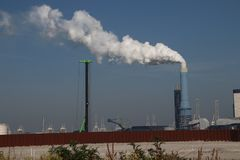 Steam comes out the chimney of the coal power plant of Engie in the Rotterdam Maasvlakte harbor in The Netherlands.  stock photos