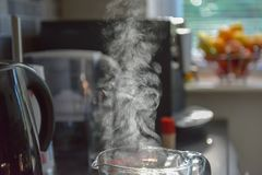 Steam coming out of water jug royalty free stock photos