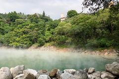 Steam coming up from the hot spring in the Thermal Valley in Taipei, Taiwan Royalty Free Stock Images