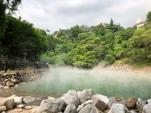 Steam coming up from the hot spring in the Thermal Valley in Taipei, Taiwan Stock Photography
