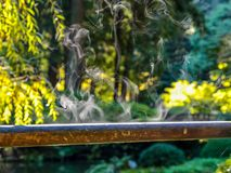 Steam coming from wet wooden railing royalty free stock photos