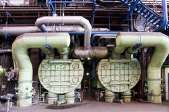 Steam condenser in power plant. Steam condenser and pipework bellow steam turbine in coal-fired power plant royalty free stock image
