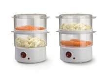 Steam cooker. With vegetables on a table Royalty Free Stock Photos