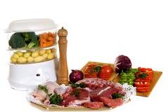 Steam cooker, steak Royalty Free Stock Image