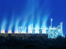Steam cooling tower of oil refinery plant. Royalty Free Stock Photos