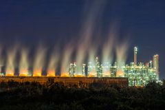 Steam cooling tower of oil refinery plant. Royalty Free Stock Images