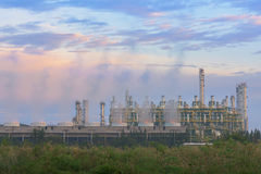 Steam cooling tower of oil refinery plant. Royalty Free Stock Image