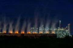 Steam cooling tower of oil refinery plant. Stock Photos