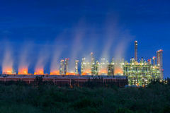 Steam cooling tower of oil refinery plant. Stock Photography