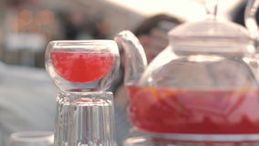 Steam from a cup with a red hot drink stock footage