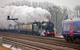 Steam and diesel passing Royalty Free Stock Images