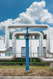 Steam distribution pipeline on factories background., Pipeline Royalty Free Stock Photos