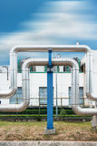 Steam distribution pipeline on factories background., Pipeline support. Stock Photos