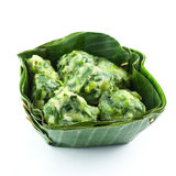 Steam dumpling stuff with garlic chives in banana leaf Royalty Free Stock Images