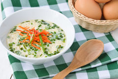 Steam eggs in a cup with green onions and carrot Royalty Free Stock Images