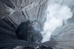Steam emerging from Mount Bromo crater. View into active volcano in Java, Indonesia Royalty Free Stock Images