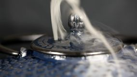 Steam emerging from tea pot. stock video footage
