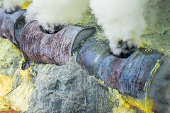Steam emerging from vents Stock Photos