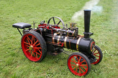 Steam engine. Mini steam traction engine in field Royalty Free Stock Photos
