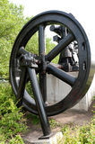 Steam engine. A wheel of a historical steam engine Stock Photography