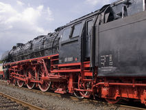 Steam engine. German steam engine in black and red varnishing stock photos