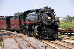Steam Engine. This is a restored steam locomotive on the tracks ready for an excursion Stock Photos