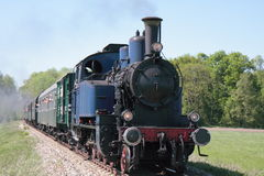 Steam engine. Old steam engine powered train approaching Royalty Free Stock Photos
