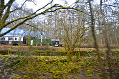 A Steam Engine Behind The Trees Royalty Free Stock Photography