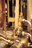 Steam Engine Brass Pipes. A photo of brass pipes on an old steam fire engine Stock Photography