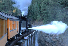 Steam Engine on Bridge in the Rocky mountains Royalty Free Stock Photography