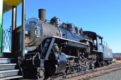Steam Engine Caboose. Closeup of old steam engine locomotive on train track stock image