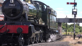 Steam engine coming to a stop 4K. Steam engine moving slowly on tracks 4K stock video footage