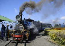 A unesco maintained heritage darjeeling railway or locomotive chuggs through the himalaya. The steam engine of Darjeeling railway at the Batasia loop of Ghum royalty free stock photography