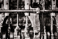 Steam Engine Grunge Detail with Manifold and Rods. Old locomotive steam engine grunge detail with crankshaft power transmission manifold and rods Stock Images