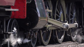 Steam engine wheels move slowly on tracks 4K stock video