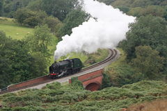 Steam Engine, North York Moors Railway. 'Schools' Class No.30926 Repton Crossing Eller Beck at Darnholm en route to Goathland to collect a train of assorted Stock Images