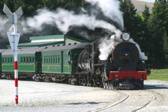 Steam Engine and Passenger Cars at the Crossing Stock Images