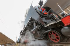 Steam engine on the rails stock photo