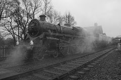 Steam engine and train. Steam engine with passenger coaches preparing to leave station stock photos