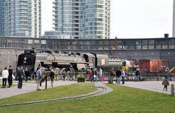Steam engine train. Old iron locomotive stands on the street as an exhibit. Photo was taken in Toronto City, Ontario province, Canada. November 2013 Royalty Free Stock Photography