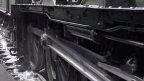 Steam engine wheels move slowly on tracks spinning 4K stock footage
